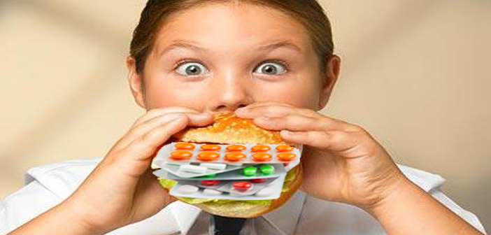 Girl (8-10) eating hamburger, portrait, close-up