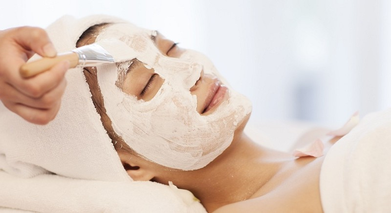 An Asian woman having facial spa treatment